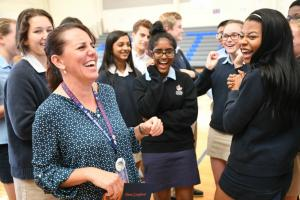 1000w Newark Charter 2017 Tami Lunsford laughs with students