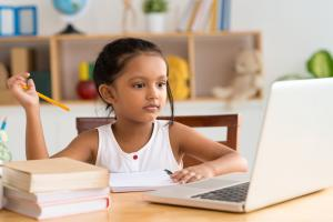 Girl engaged in distance learning 1000w