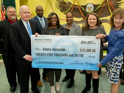 Amara Alexander check with dignitaries