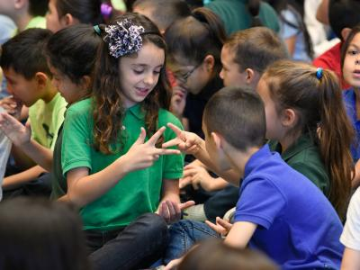 Amy Biehl students rock paper scissors