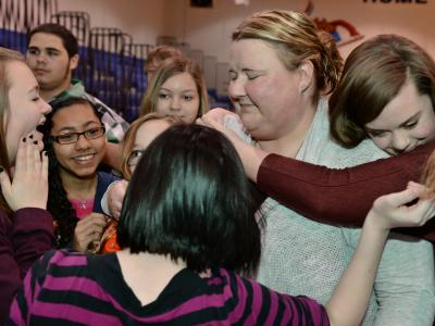 Bode Middle hug from students