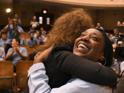 Bronx 2017 Jane Foley hugs Aja Brown Metrosound
