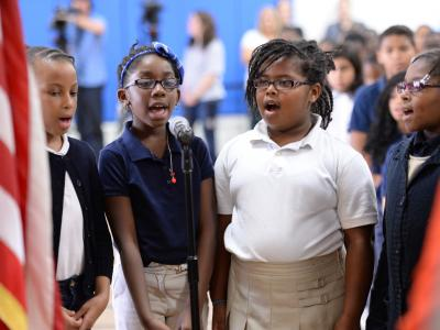 Desi Nesmith students sing national anthem