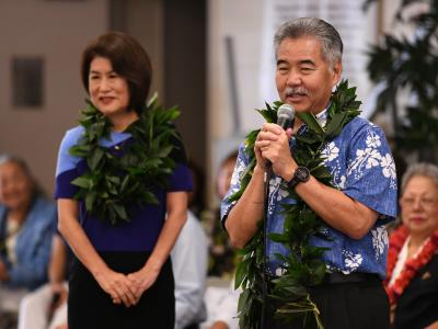 Governor David Ige congratulates Kelly Sutcliffe