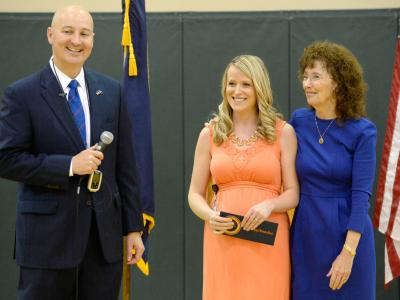 Governor Pete Ricketts and Jane Foley congratulate Courtney Matulka