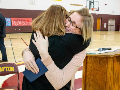 Grafton 2018 Brittany Larson colleague hug
