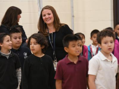 Jennie Schmaltz leads class to assembly