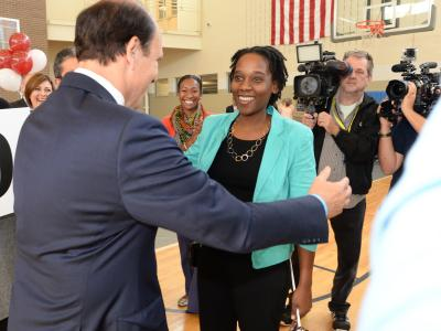 Kena Allison greeted by Mike Milken