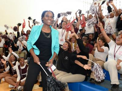 Kena Allison smiles students cheer wildly