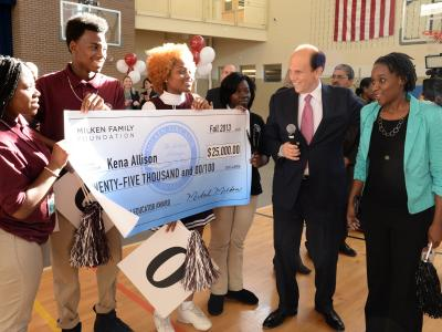 Kena Allison with Mike Milken and 25000 check
