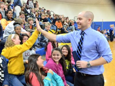 Kevin Winters high fives student