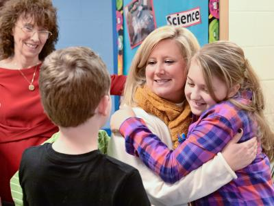 Krystle Bryant gets hugs from students
