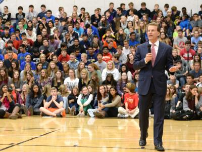 Lowell Milken addresses Blue Valley NW HS