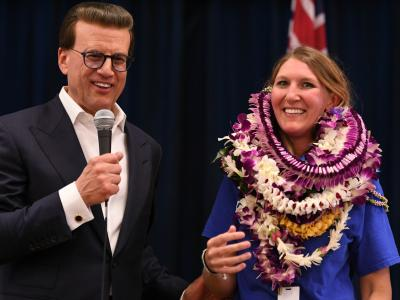 Lowell Milken congratulates Kelly Sutcliffe