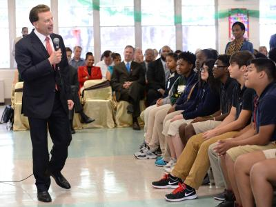 Lowell Milken talks to Port Allen students