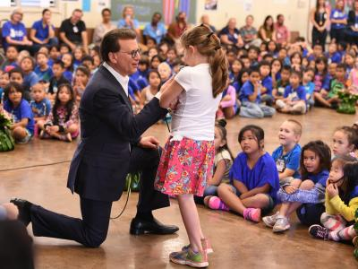 Lowell Milken with Jefferson Elementary student