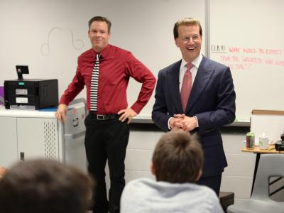 Lowell Milken with students in classroom