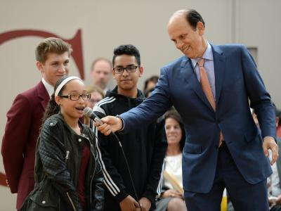 Michael Milken introduces kids to assembly