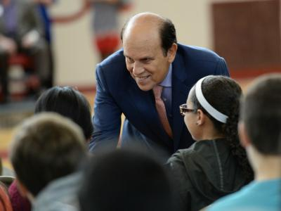 Michael Milken meets kids before assembly