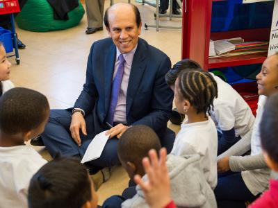 Michelle Johnson Mike Milken gets autographs from students