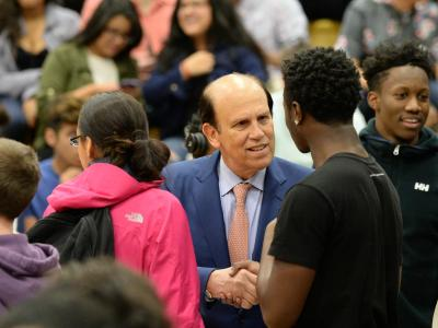 Mike Milken chats with students