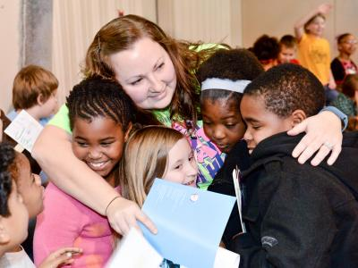 Nicole Castile hugs students
