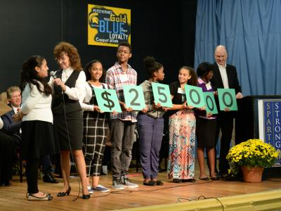 Samuel Slater kids spell out amount of Milken Award check