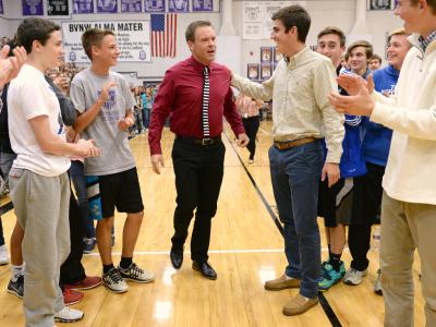 Students help Bill Smithyman to his feet