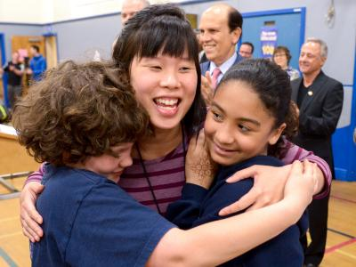 Teresa Chan Seidel gets hugs from students