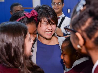 Tracy Espiritu gets hugs from students