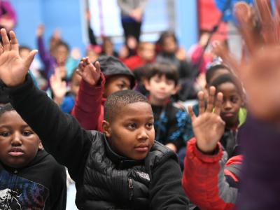 Weinland Park students hands up