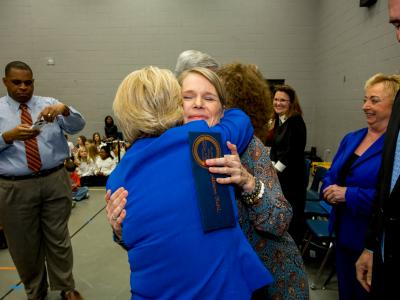 Allison Ruhl hug from First Lady Deborah Bryant