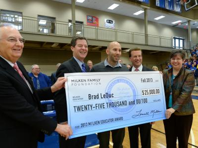 Brad LeDuc Lowell Milken and VIPs with check