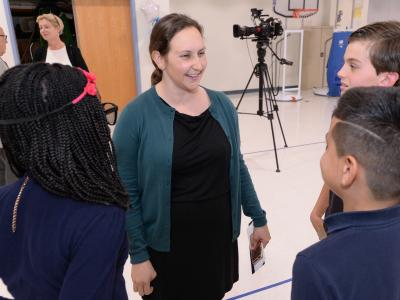 Emily Caldarelli talks with students