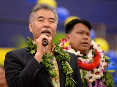 Governor David Ige congratulates Michael Sana