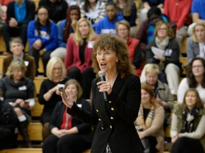 Jane Foley addresses assembly Shortridge HS