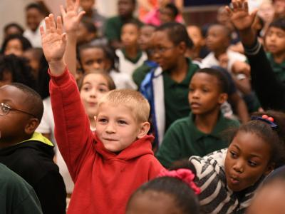 Jeanerette students hands up
