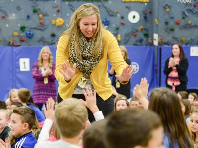 Jessica Karll gets high fives from students