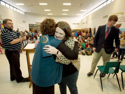 Kara Davis hugs principal at end