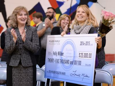 Kelly Wilber applauded with check