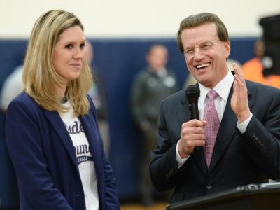 Lowell Milken congratulates recipient