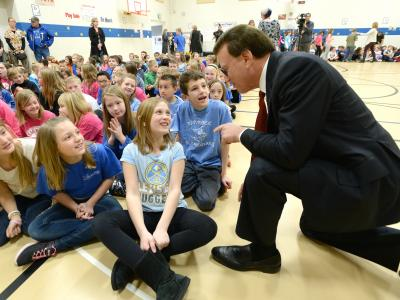 Lowell Milken talks with Rim Rock students before assembly