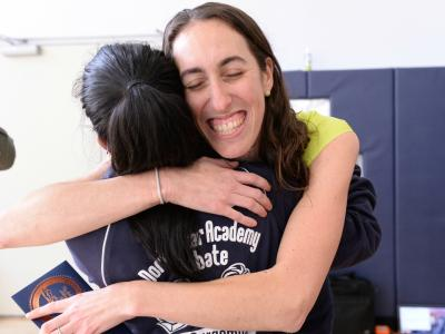 North Star Academy student hugs Allison Cuttler