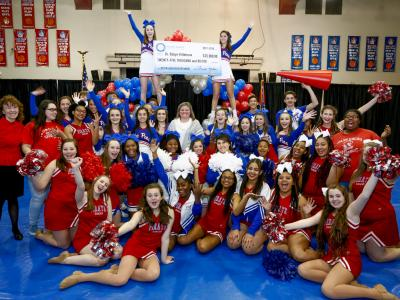 Pass Christian 2017 cheerleaders celebrate Robyn Killebrew