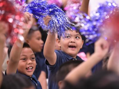 Paul Cuffee students wave pompoms