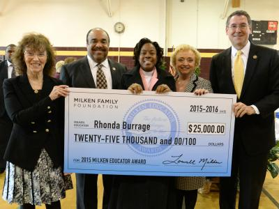 Rhonda Burrage check with dignitaries