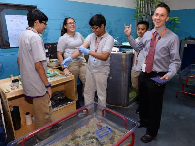 Robert ODonnell with students in the aquaculture lab