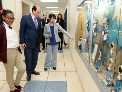 Tracy Espiritu and Mike Milken look at awards