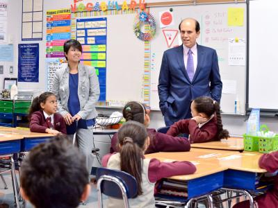 Tracy Espiritu and Mike Milken teaching class