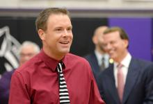 Bill Smithyman smiles after Milken Award